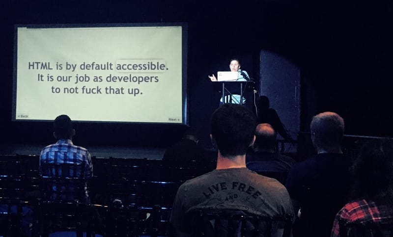 "Estelle Weyl at Flashback Conference 2020 in Orlando. Slide text reads, ""HTML is by default accessible. It is our job as developers not to fuck that up."""